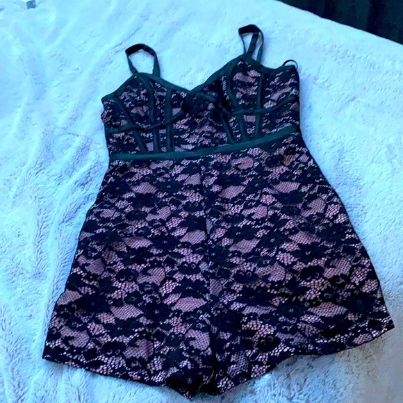 Bebe romper size M color black lace with pink